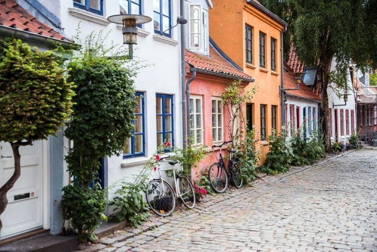 Jutland! It's the mainland region of Denmark, and it has so many amazing towns. Aarhus is the largest city in Jutland, and it has quaint historic streets, a contemporary art museum with a rainbow you can walk through, pedestrian shopping streets, and beautiful beaches.