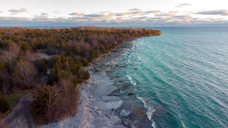 Point Petre in Prince Edward County, Ontario. The clear water of Lake Ontario, the limestone coastline and the natural rural setting is only minutes from Easterbrook Airbnb.