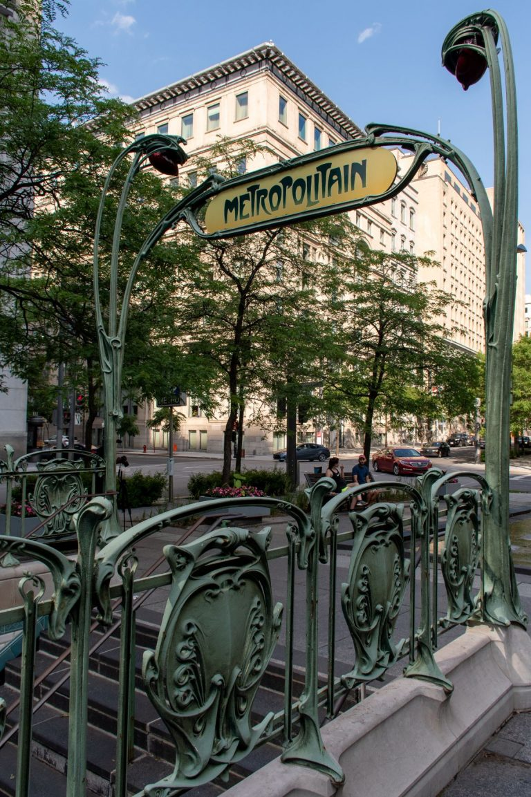 Victoria Square is a public space in Old Montreal that features the art nouveau sign from Paris, gifted to the city.