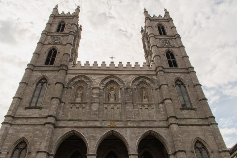 The Notre-Dame Basilica is a basilica in the historic district of Old Montreal, in Montreal, Quebec, Canada. The church is located at 110 Notre-Dame Street West, at the corner of Saint Sulpice Street. It is located next to the Saint-Sulpice Seminary and faces the Place d'Armes square.