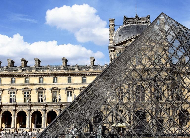 One of Paris' most famous landmarks is the Louvre. A museum famously where an original Mona Lisa is hung.
