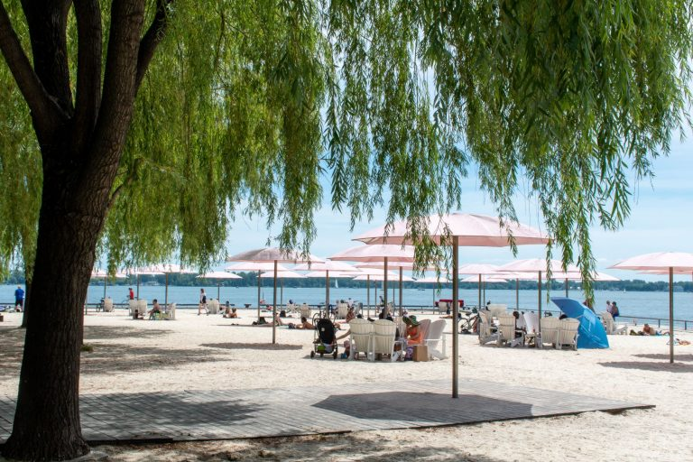 Visit Toronto's urban beach which is directly across Redpath Sugar Refinery.