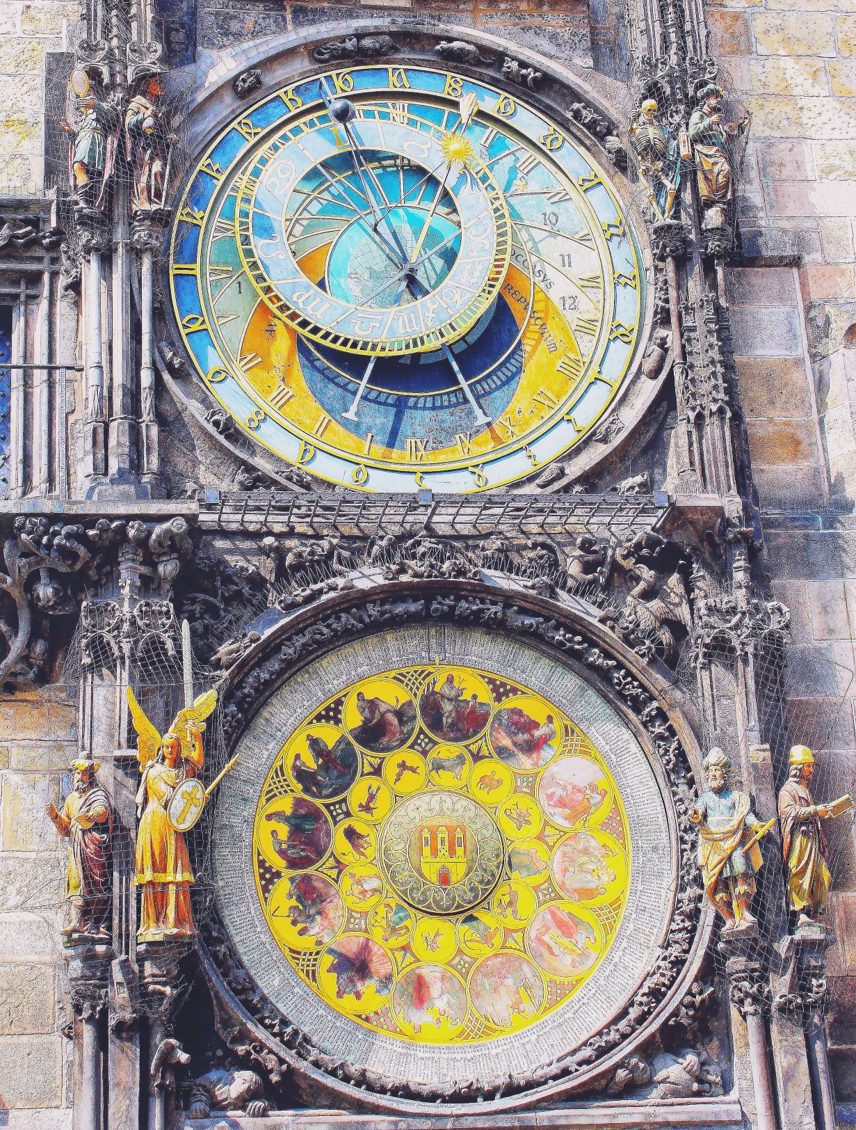 Astronomical clock Every hour, on the hour from 8am to 8pm, since 1490, the Old Town hall's Astronomical Clock comes alive. The details are impressive with the phases of the Zodiac and sunrise and sunset times. The 12 saints, visible through a window above the clock face, march by while four figures representing Greed, Vanity, Death and Turk nod their heads.