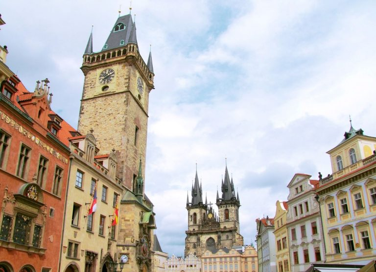 Prague's Old Town Hall from early 12th century sits on the busy main square