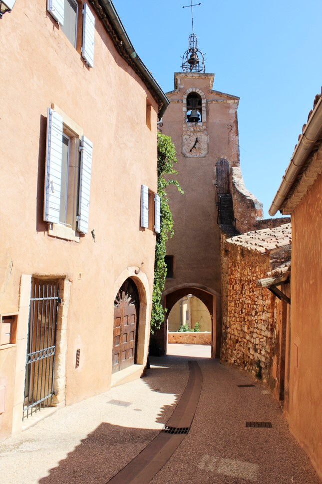 Roussillon, Provence, France. This village is situated in one of the largest ochre deposits in the world and is surrounded by magnificent red cliffs, ochre quarries and lush green pine trees.