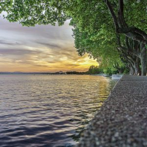 Holiday in Lake Constance Germany. Surrounded by charming towns, castles and views of the Alps. It straddles both Austria and Switzerland.