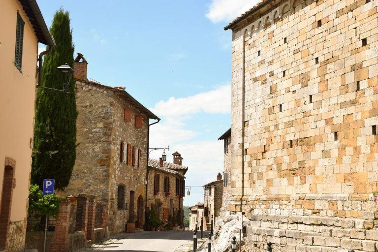 Cortona, a stone-clad town in Tuscany, Italy with a magnificent medieval tower. It's larger and busier piazza and endless winding alleyways to wander means you need to add this to your list.