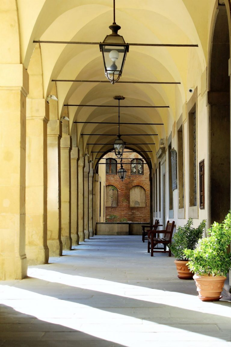 Visit Arezzo, in Tuscany Italy. It is a larger city full of museums, art galleries, antique markets, fine shops, monuments, and historical buildings